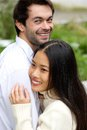 Happy couple smiling and hugging outdoors close up portrait of a Royalty Free Stock Photos