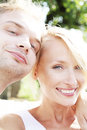 Happy couple smiling photo of beautiful looking at camera and summer day Royalty Free Stock Image