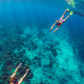 Happy couple snorkeling underwater over coral reef Royalty Free Stock Photo