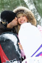 Happy couple with snowboards Royalty Free Stock Photos
