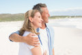 Happy couple spending time together at the beach Stock Images