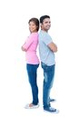 Happy couple standing back to back on white background Royalty Free Stock Image