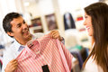 Happy couple store shopping shirts Stock Images