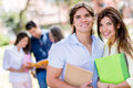 Happy couple of students university holding notebooks Royalty Free Stock Image