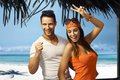 Happy couple on summer holiday young dancing tropical beach at Royalty Free Stock Photos