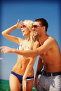 Happy couple in sunglasses on the beach picture of focus woman Stock Images