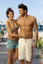 Happy couple in swimsuit at holiday beach resort Royalty Free Stock Photo