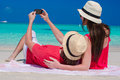 Happy couple taking a photo themselves on tropical beach Royalty Free Stock Images