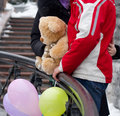 Happy couple with teddy bear and balloons expecting Stock Image