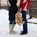 Happy couple with teddy bear expecting Royalty Free Stock Photos