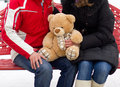 Happy couple with teddy bear expecting Stock Photos