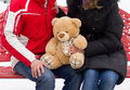 Happy couple with teddy bear expecting Stock Images