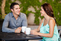 Happy couple on their first date good looking latin drinking coffee and smiling at a restaurant Stock Photography