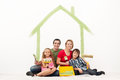Happy couple with two kids repainting their home Royalty Free Stock Photo