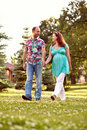 Happy couple walk in park Royalty Free Stock Image