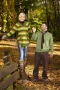 Happy couple walking in autumn park Royalty Free Stock Photography