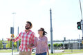 Happy couple walking in city against clear sky Royalty Free Stock Images