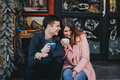 Happy couple in warm clothes drinking coffee on a Christmas market Royalty Free Stock Photo