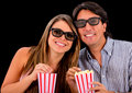 Happy couple watching a d movie and wearing glasses Royalty Free Stock Photo