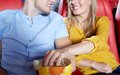Happy couple watching movie in theater or cinema Royalty Free Stock Photo