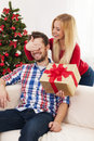 Happy couple young beautiful women has surprise for her boyfriend Royalty Free Stock Photos