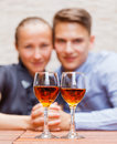 Happy couple young drinking wine in a restaurant Stock Images