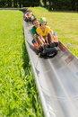 Happy couples enjoying alpine coaster luge young during summer Stock Images