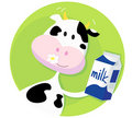 Happy cow with milk box on green background Royalty Free Stock Photo