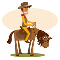 The happy cowboy astride a horse Royalty Free Stock Image