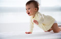 Happy crawling baby. Royalty Free Stock Photo