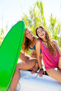 Happy crazy teen surfer girls smiling on car white convertible Royalty Free Stock Photo