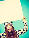 Happy crazy woman in cow costume holding board Royalty Free Stock Photo