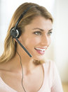 Happy customer service representative looking away female wearing headset Royalty Free Stock Photography