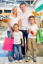 Happy customers vertical shot of a shopping family being with their spree weekend Stock Photo