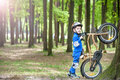 Happy cute blond kid boy having fun his first bike on sunny summer day, outdoors.  child making sports. Active leisure for childre Royalty Free Stock Photo
