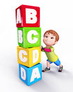 Happy Cute boy with blocks of alphabets Stock Photos