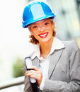 Happy cute female architect holding a project file Royalty Free Stock Images