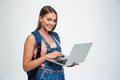 Happy cute female student using laptop Royalty Free Stock Photo
