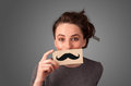 Happy cute girl holding paper with mustache drawing on gradient background Royalty Free Stock Photography