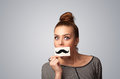 Happy cute girl holding paper with mustache drawing Royalty Free Stock Photo