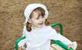 Happy cute girl rides on small carousel Stock Photography