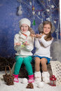 Happy cute girls plaing with snowflake christmas concept beautiful girl in warm clothing playing snow Stock Photography