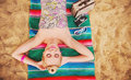 Happy cute hot body young woman lying on the beach with colorful Royalty Free Stock Photo