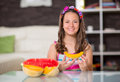 Happy cute little girl eating melon Royalty Free Stock Photo