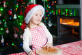 Happy cute little girl in the kitchen baking gingerbread this image has attached release Stock Photography