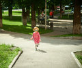 Happy cute little girl running in the park. Happiness. Royalty Free Stock Photo