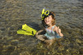 Happy cute snorkel girl on vacation Stock Photo