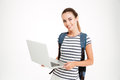 Happy cute student girl with backpack standing and holding laptop Royalty Free Stock Photo