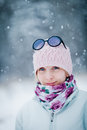 Happy cute woman enjoying winter during a snowy day Stock Photo