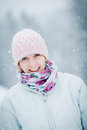 Happy cute woman enjoying winter during a snowy day Royalty Free Stock Photography